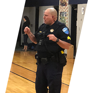 Tulalip Tribal Police officer presenting to the community header sliding image.