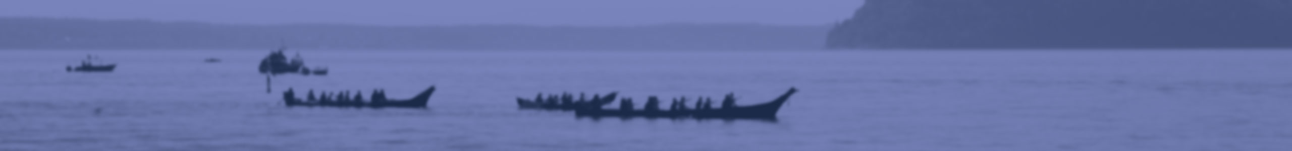 Image of bay with tribal canoes and citizens of Tulalip Tribes background header.